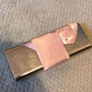 Sean Jean metallic pink clutch